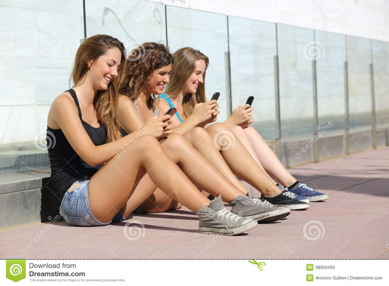 Group of teenager girls texting on smart phone