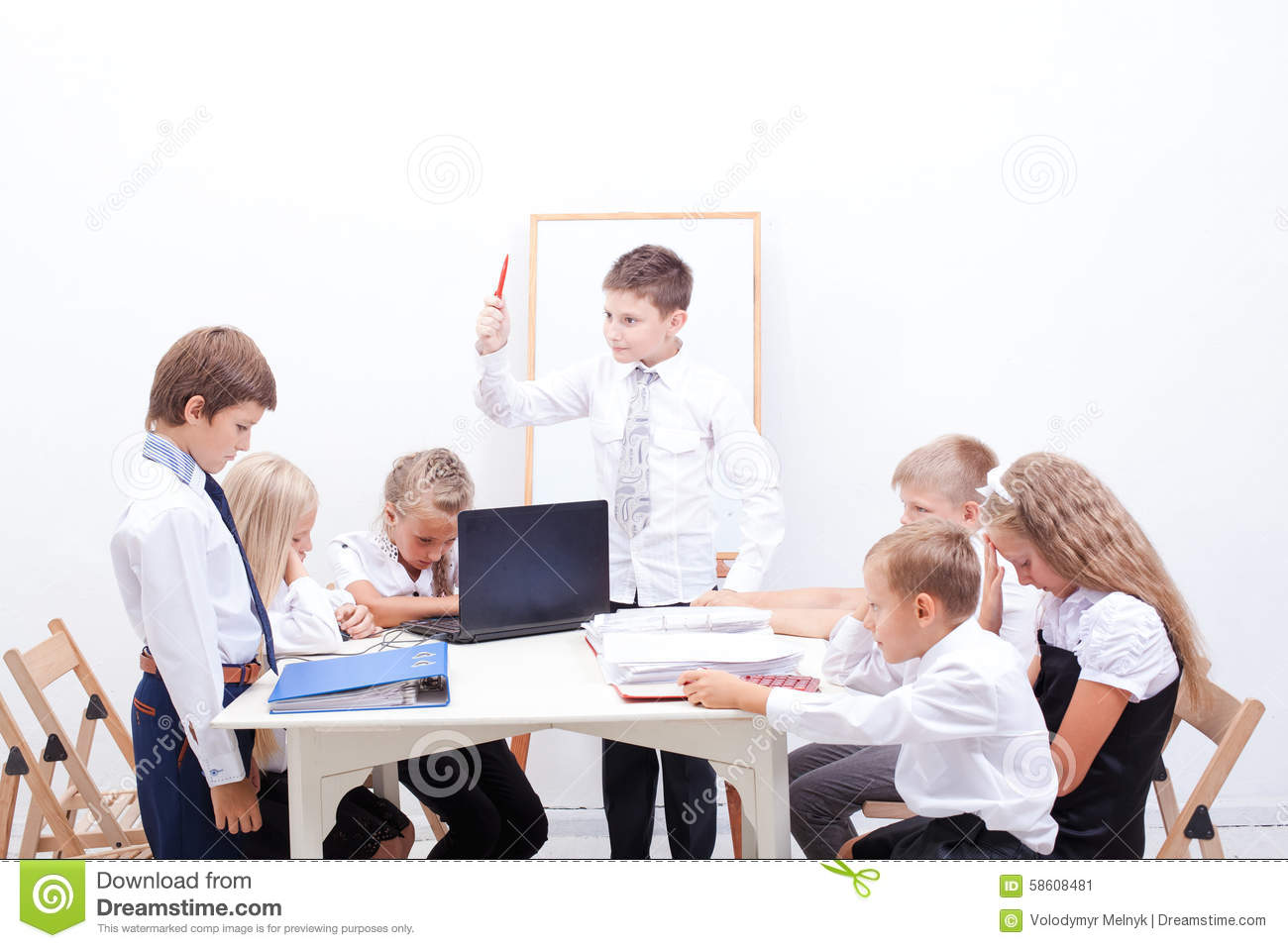 The group of teenagers sitting in a business