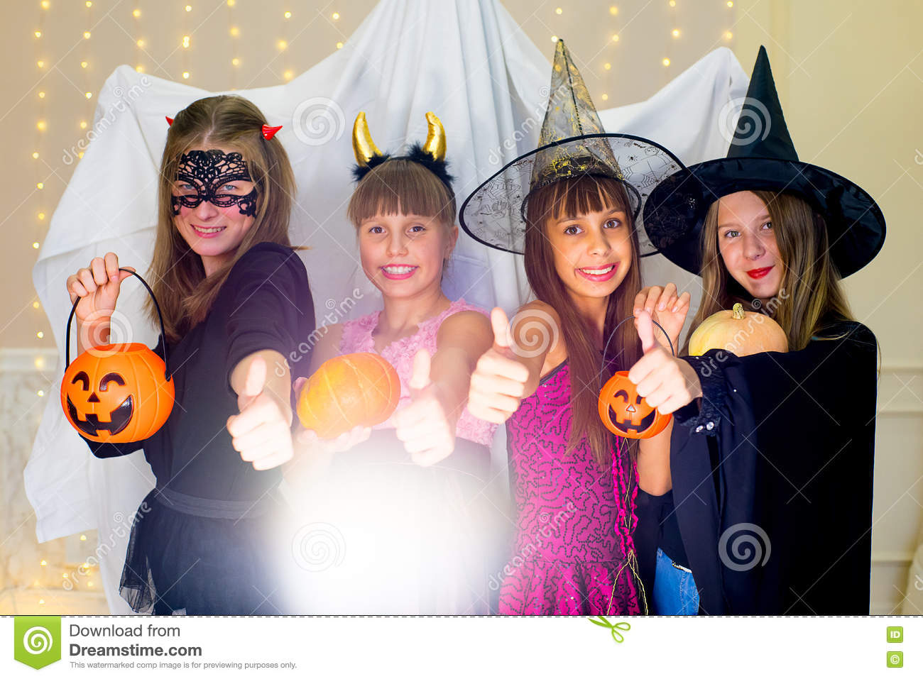 Group Of Teenagers Wearing Halloween Costumes Fear Of Ghost Stock ...