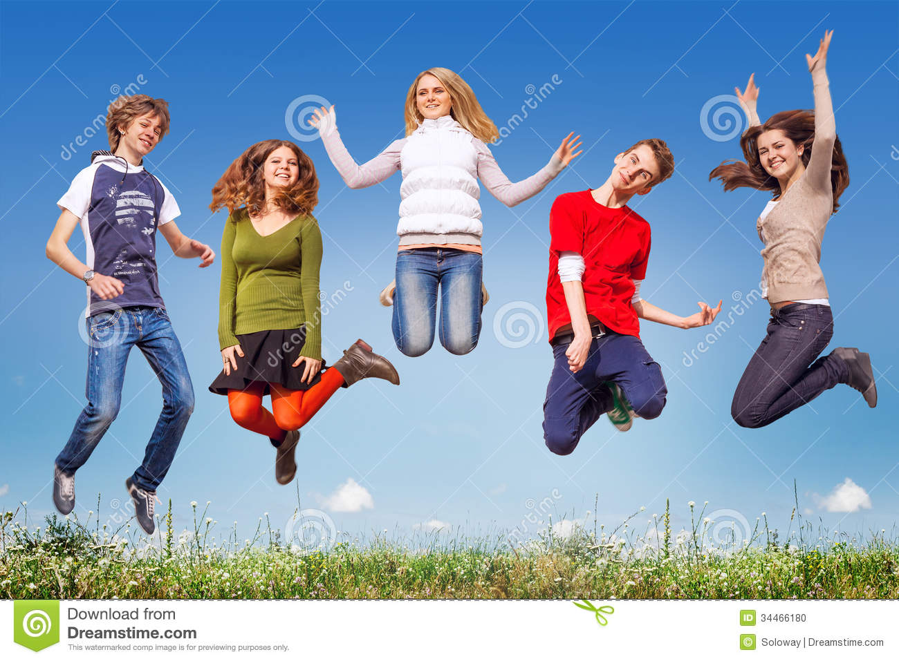 Group Of Teens Jumping In The Blue Sky Above The Green