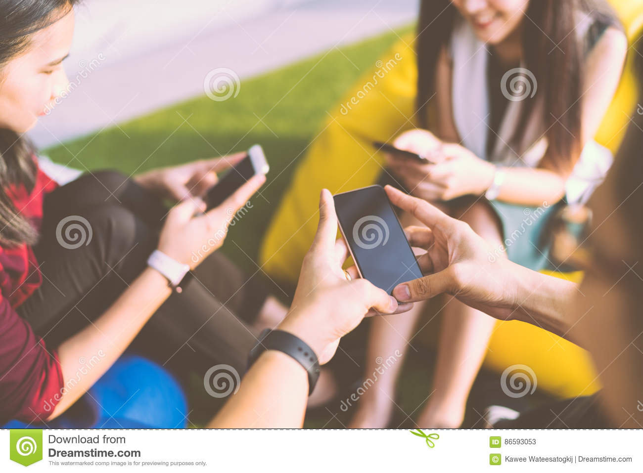 Group of three young people using smartphones together, modern lifestyle or communication technology gadget concept