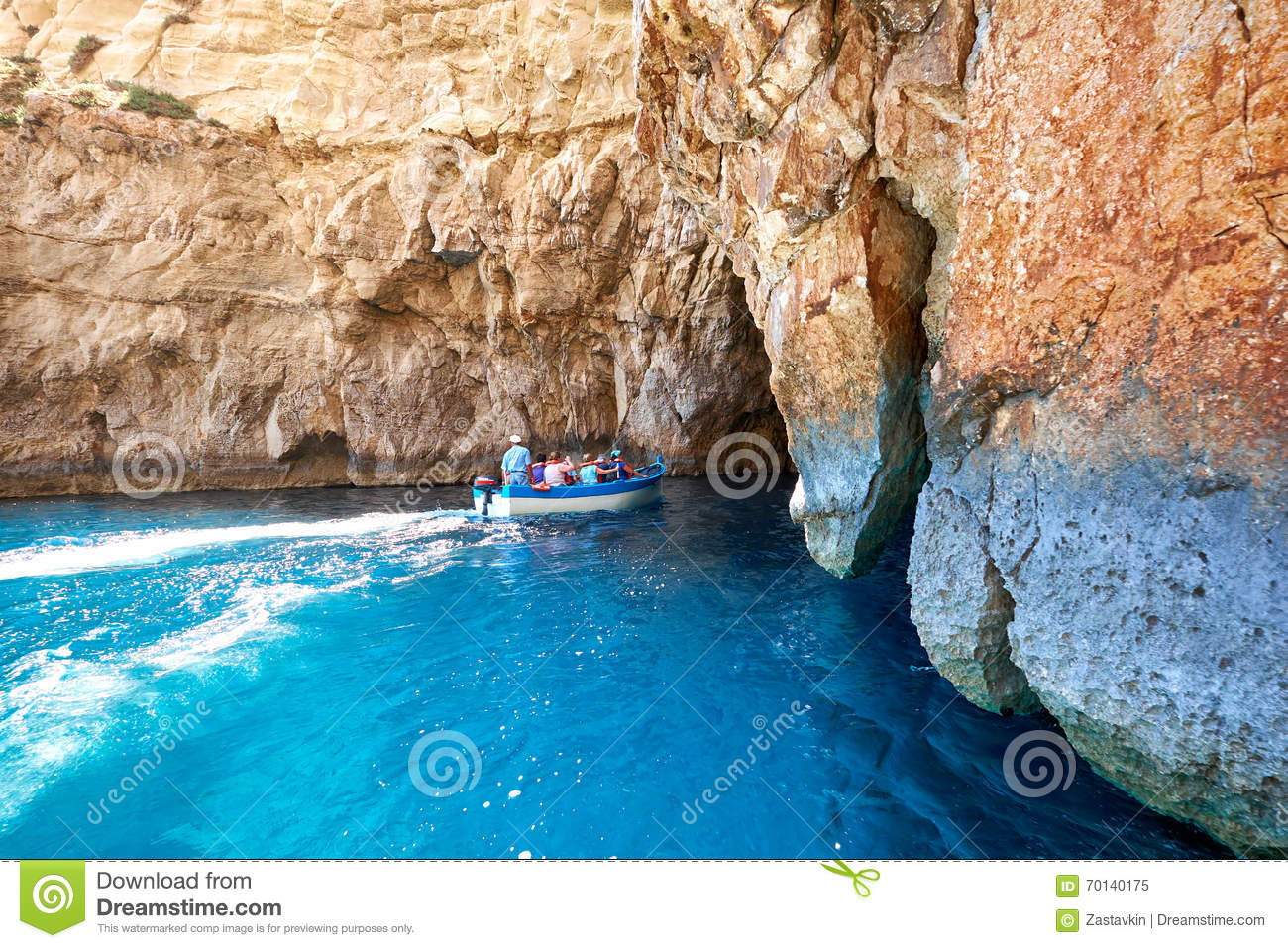 Group of torists visit Blue Grotto - famuous sea cave on south p