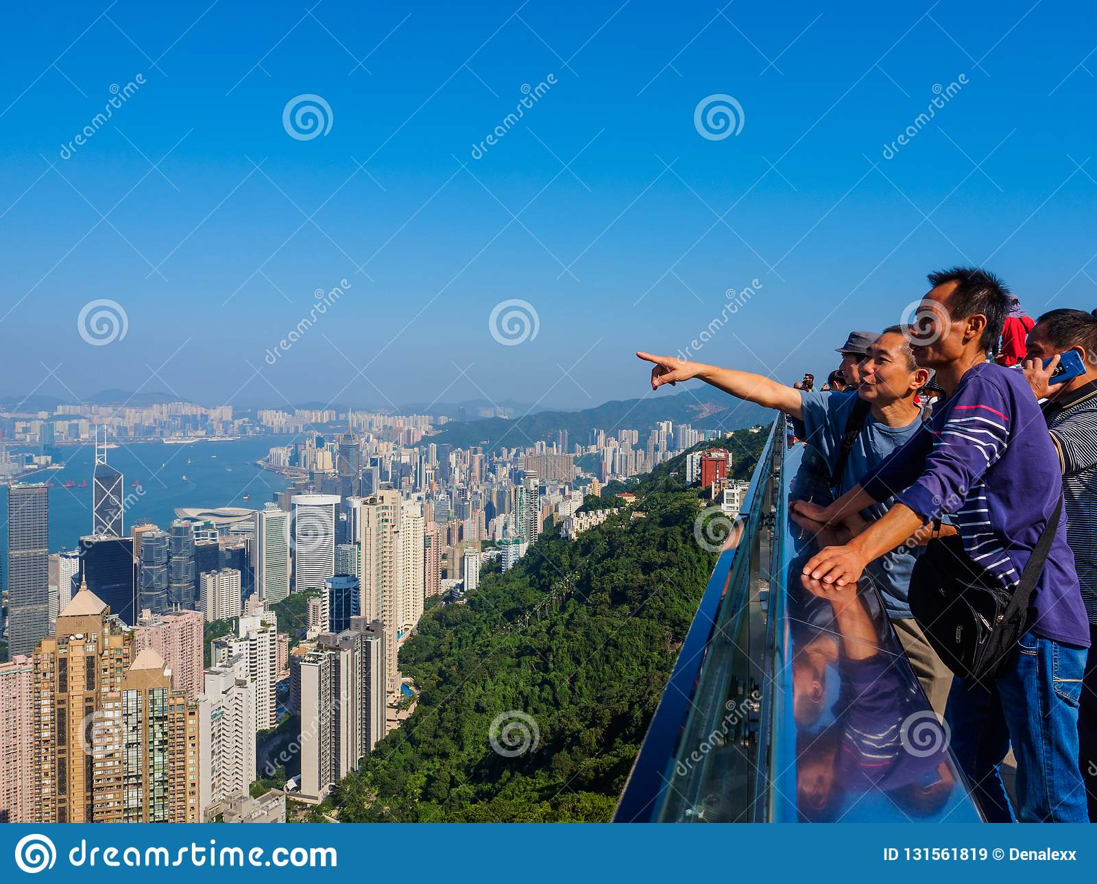 A group of tourists from the Chinese mainland, enjoying the view over Hong Kong from the