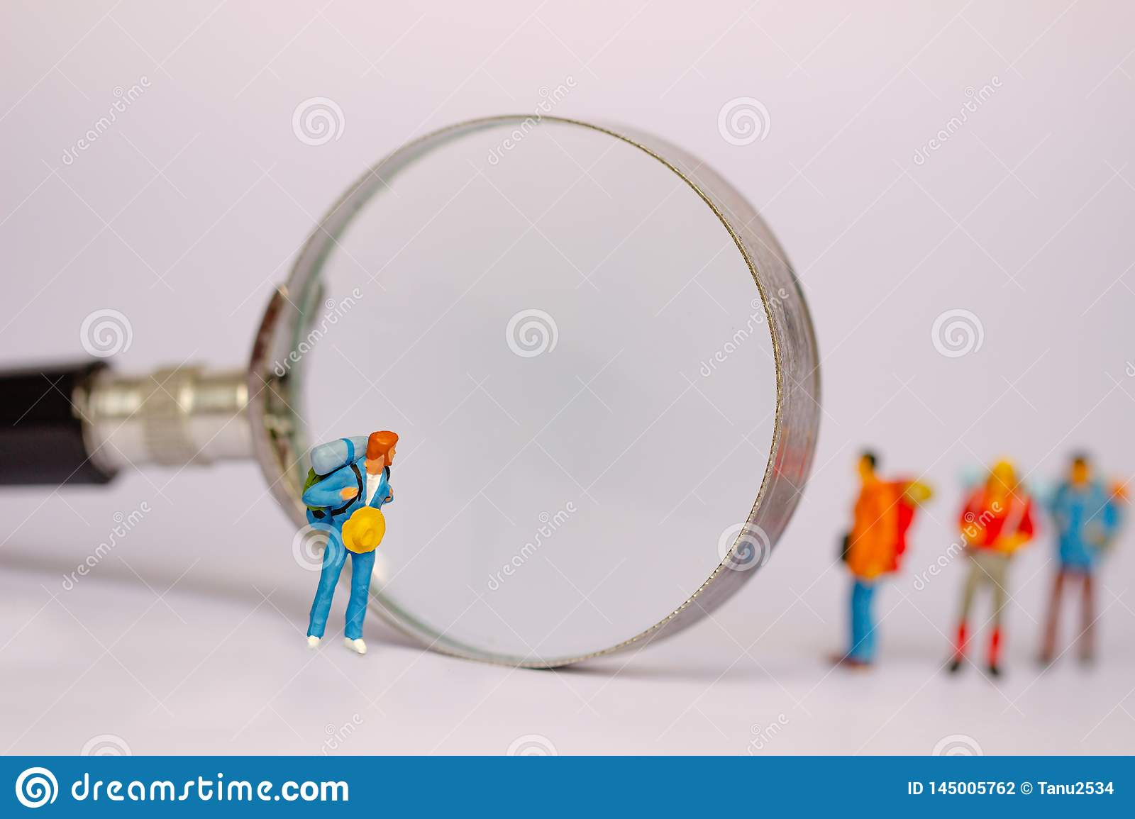 Group of tourists and magnifier isolated on white background. Travelling concepts.