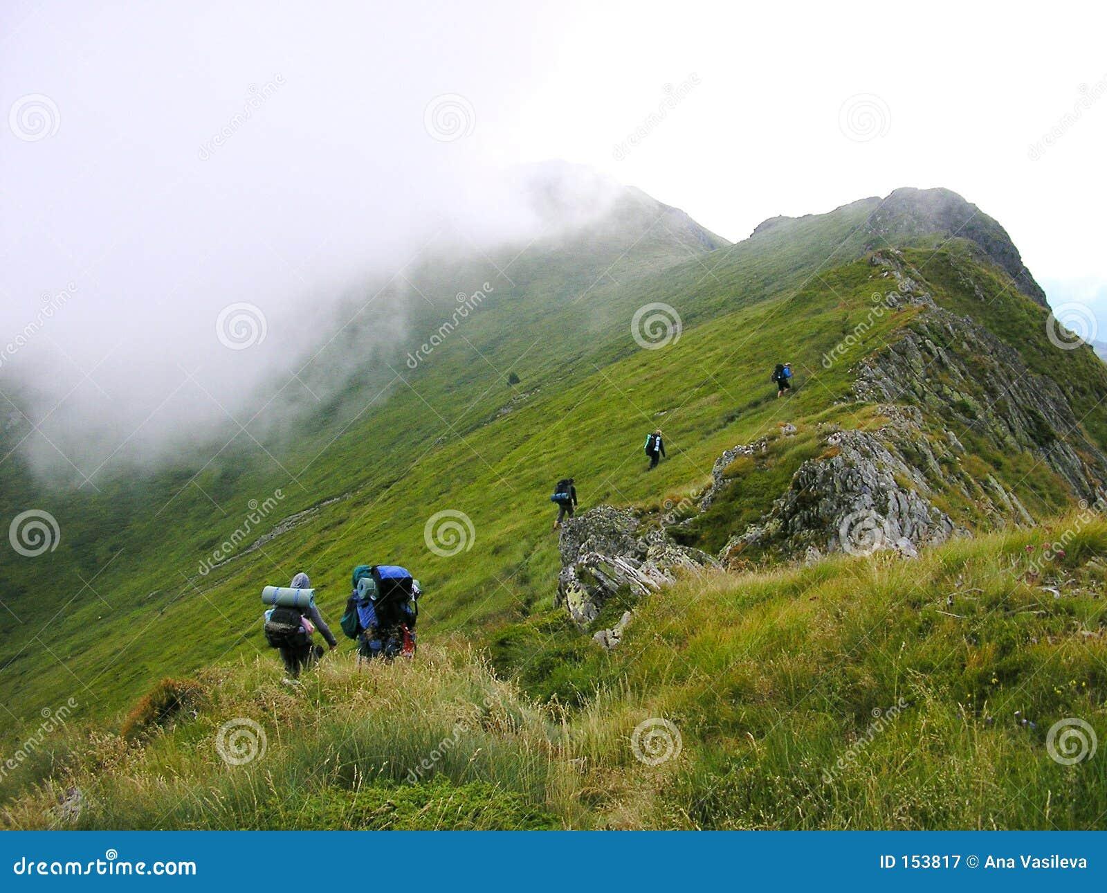 A Group Of Tourists On A Mountain Ridge