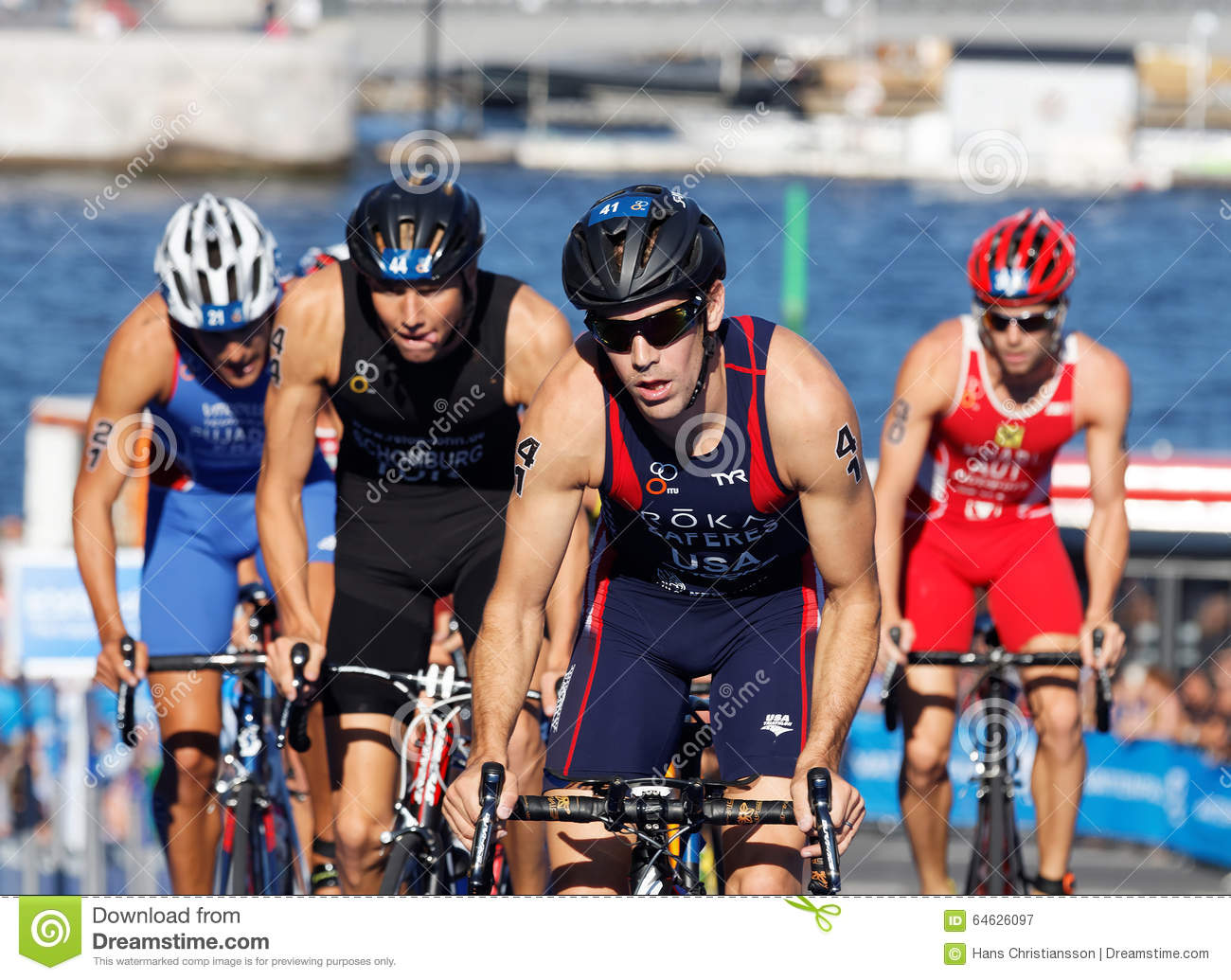 Group Of Triathlon Competitors Cycling Uphill Editorial ...