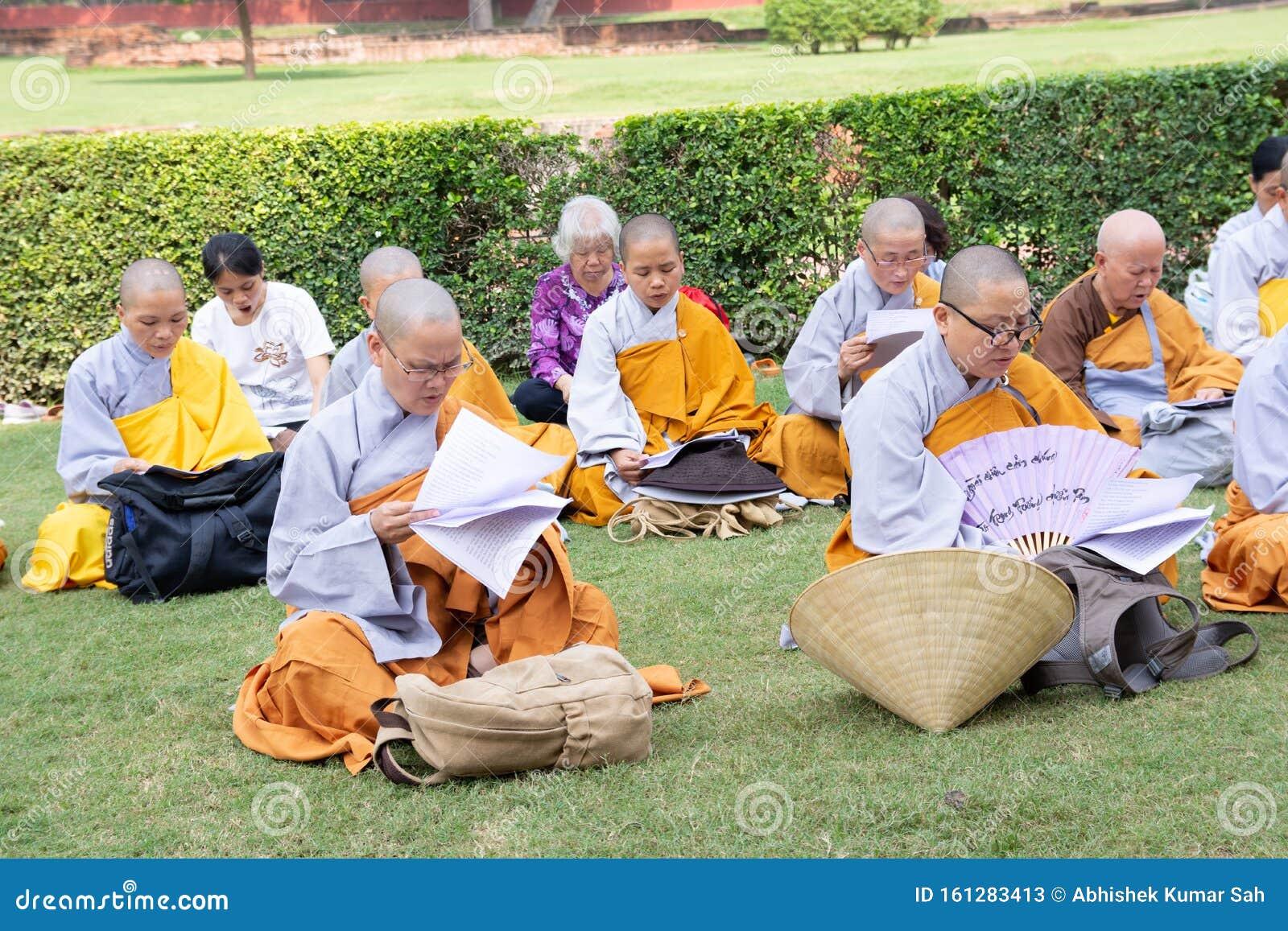 Group Of Unidentified Buddhist Monk Praying Near Dhamek ...