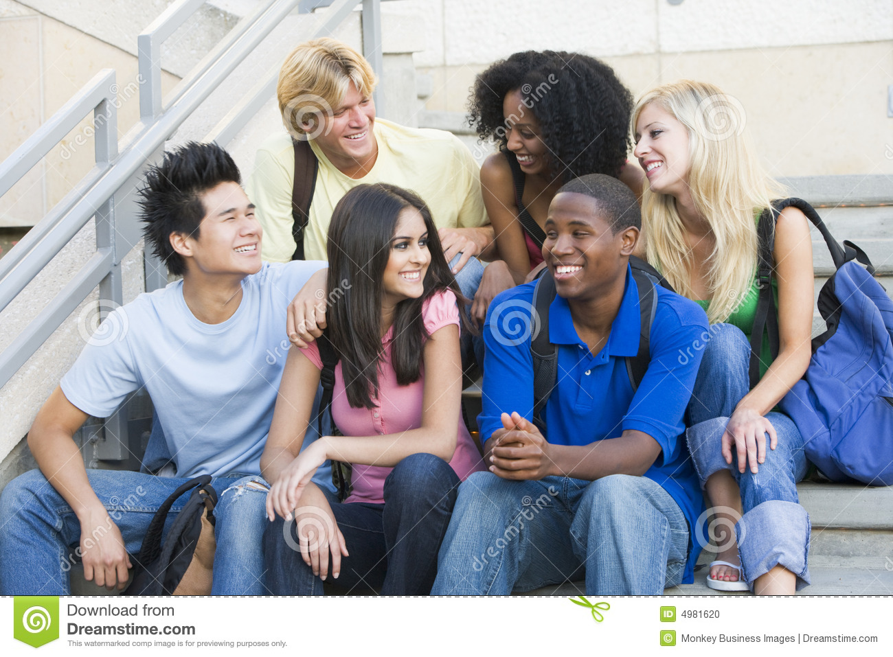 Group Of University Students Sitting On Steps Stock Photo