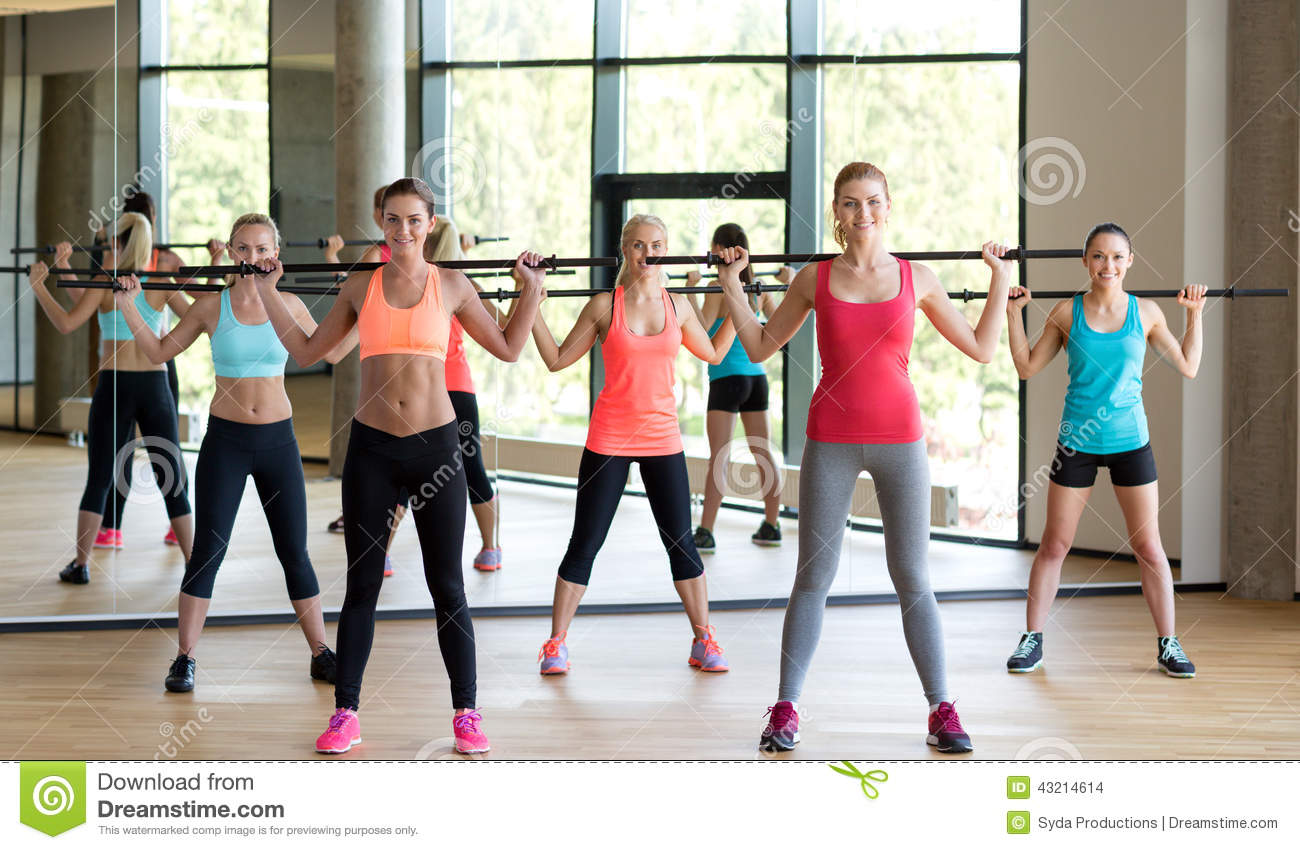 Group of women with bars in gym royalty free stock for Gimnasio sport gym