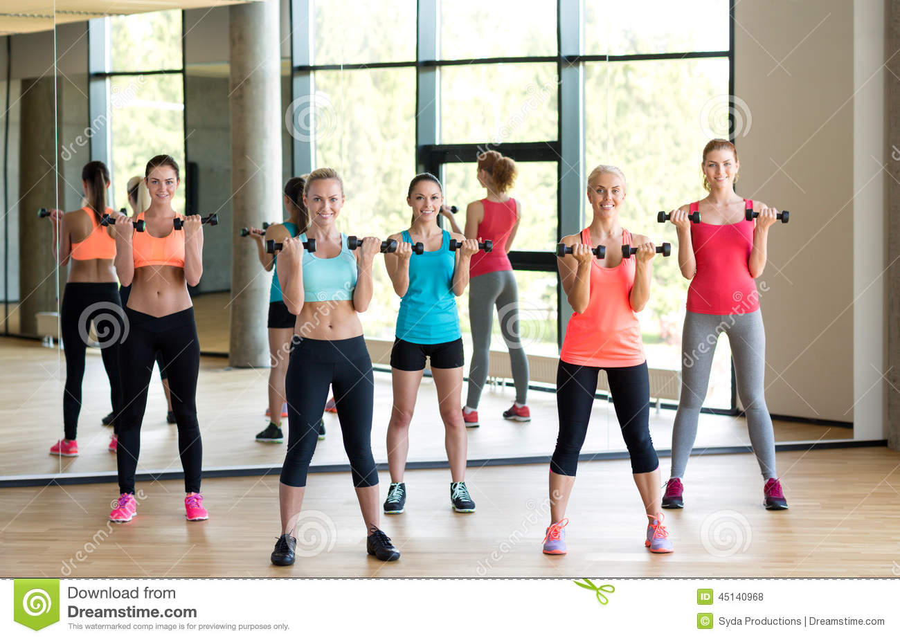 Group of women with dumbbells in gym royalty free stock for Gimnasio sport gym