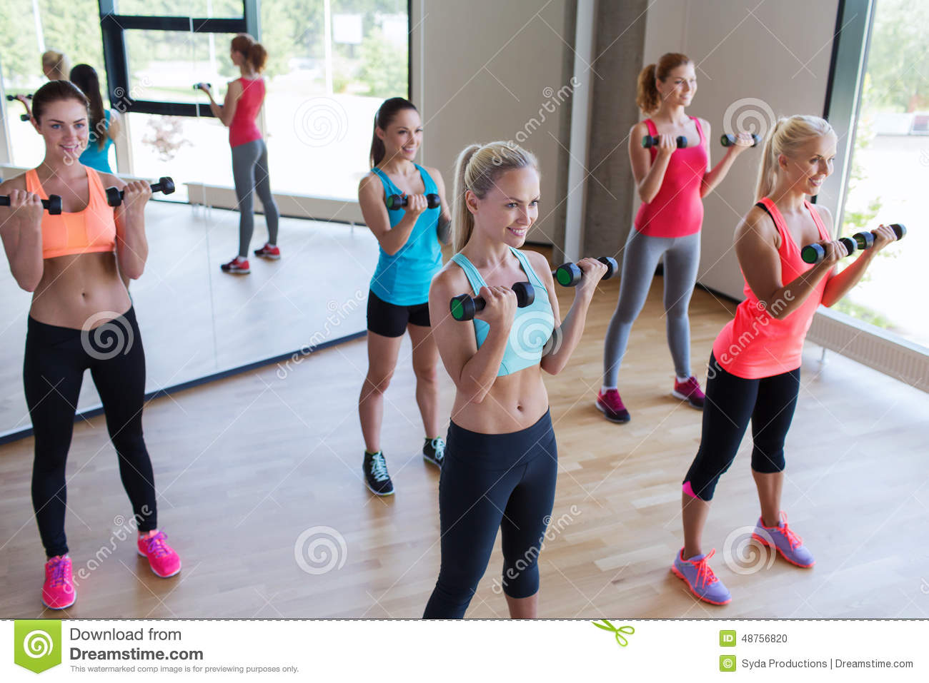 Group of women exercising with dumbbells in gym stock for Gimnasio sport gym