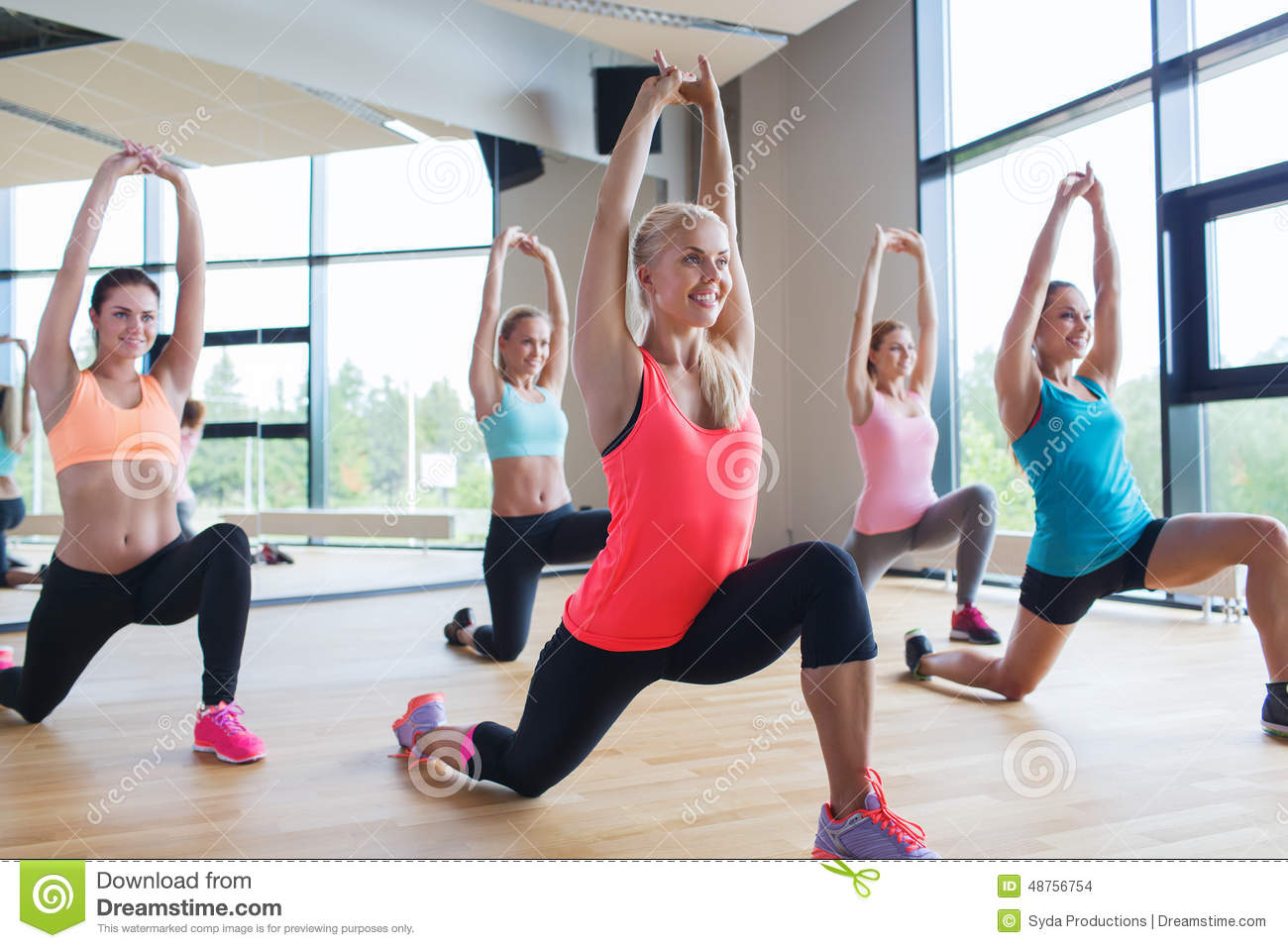 group of women making lunge exercise in gym stock photo image 48756754. Black Bedroom Furniture Sets. Home Design Ideas