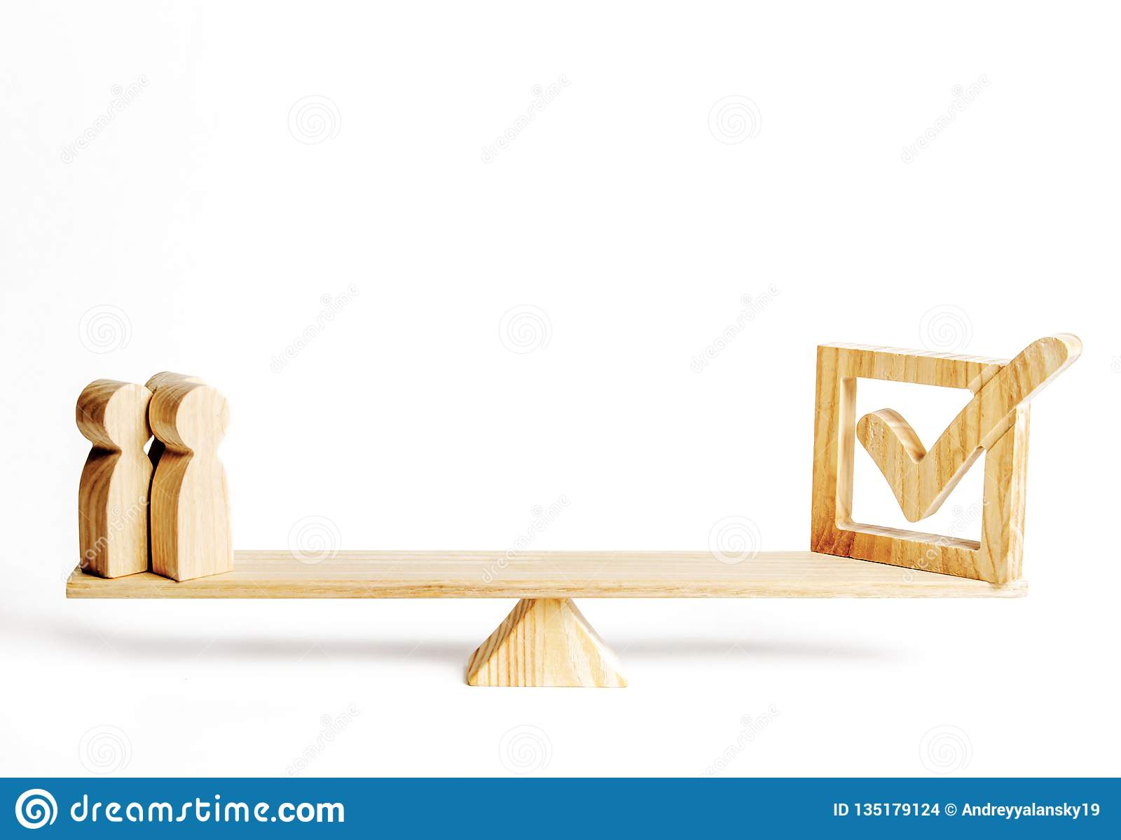 A group of wooden figures of people and wooden check mark on the scales. concept of political support, voting for laws