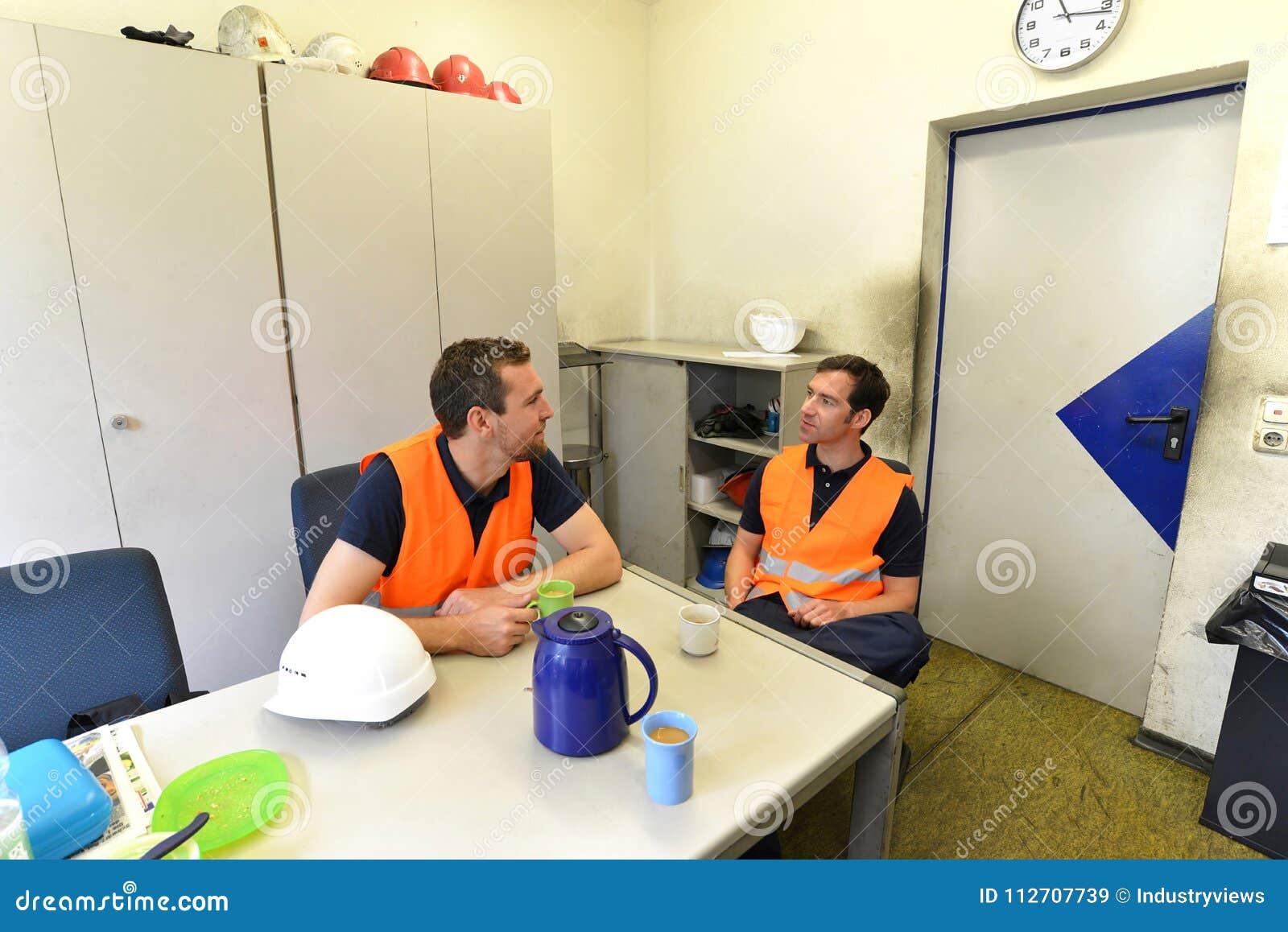 Take Break Coffeebreak : Group of workers in an industrial company take a coffee break