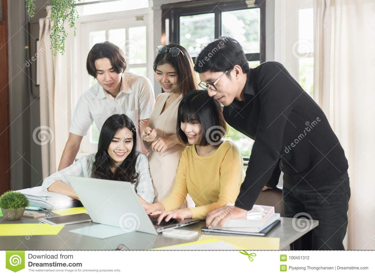 Group of young asian students high school working report together in the library