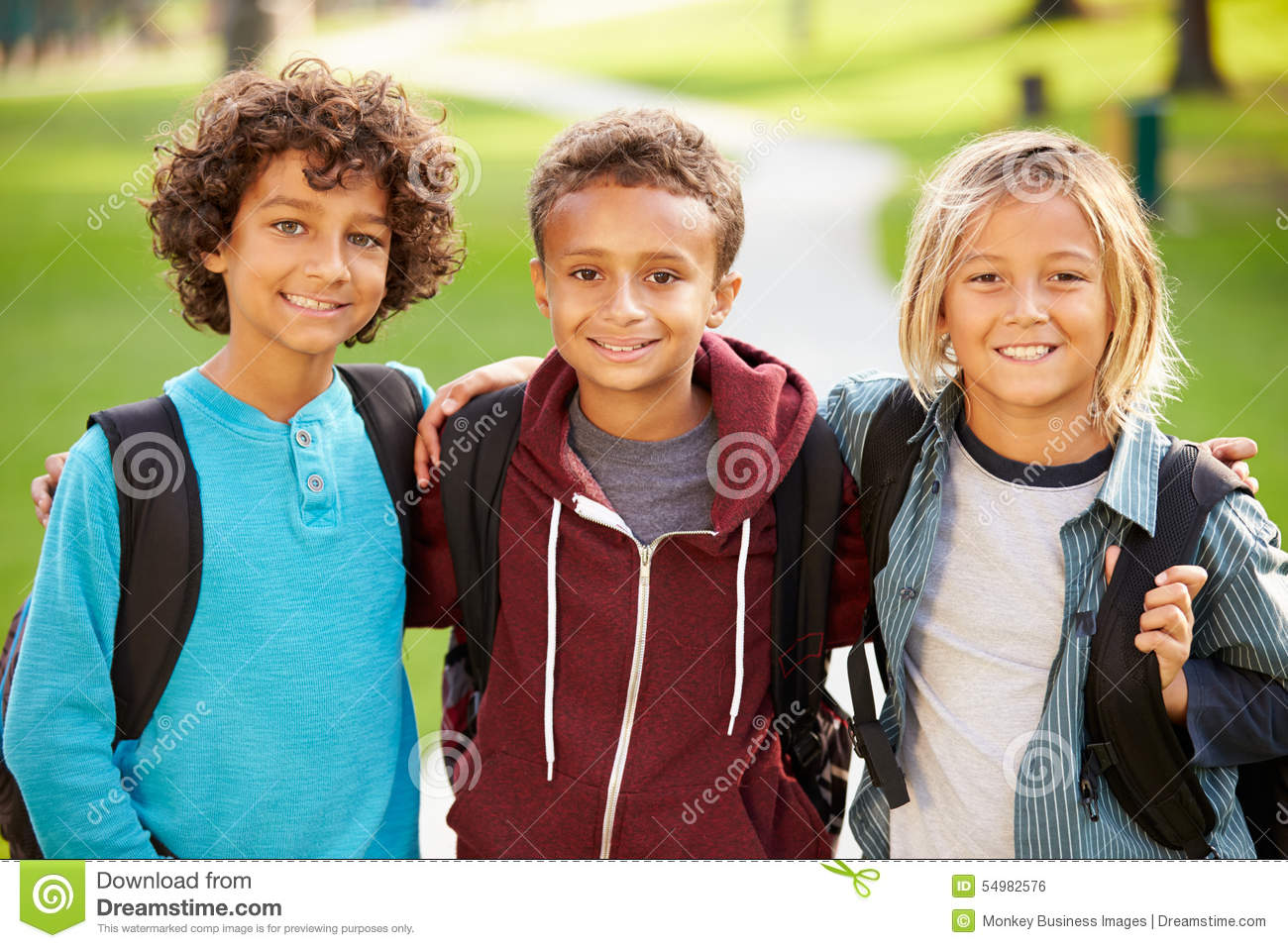 Group of young boys hanging out in park together stock for Hanging groups of pictures