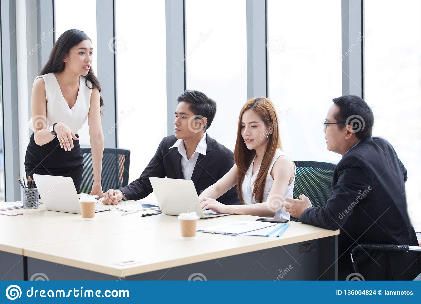 Group Of Young Business People Brainstorming Together In The