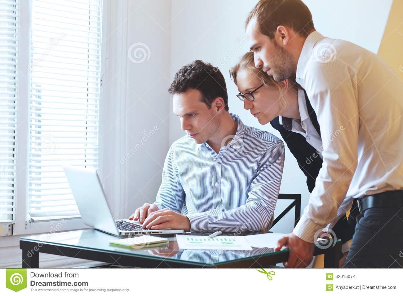 group of young business people looking at laptop mba