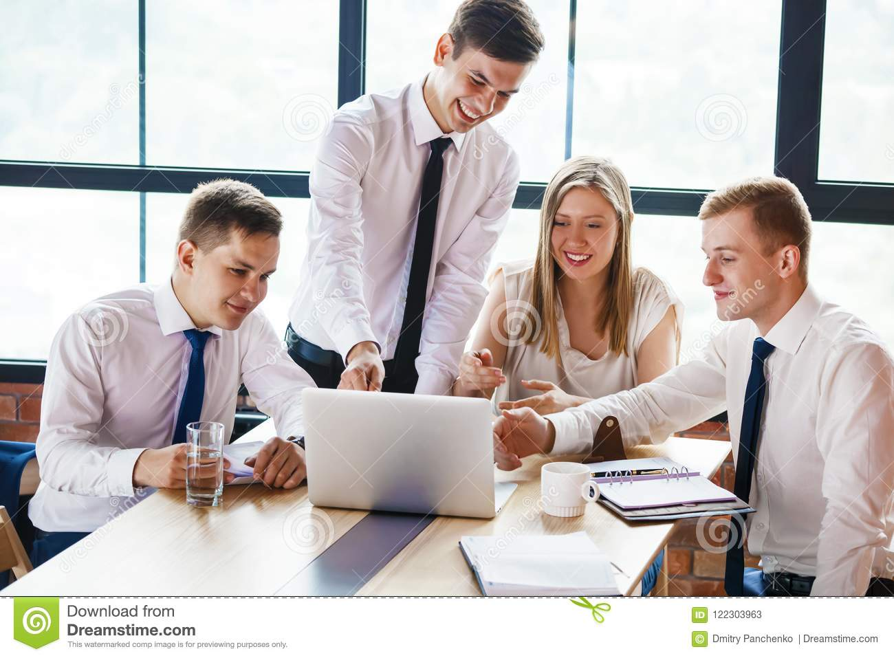 Group Of Young Business People Working In Office. Stock Image - Image of  office, laptop: 122303963