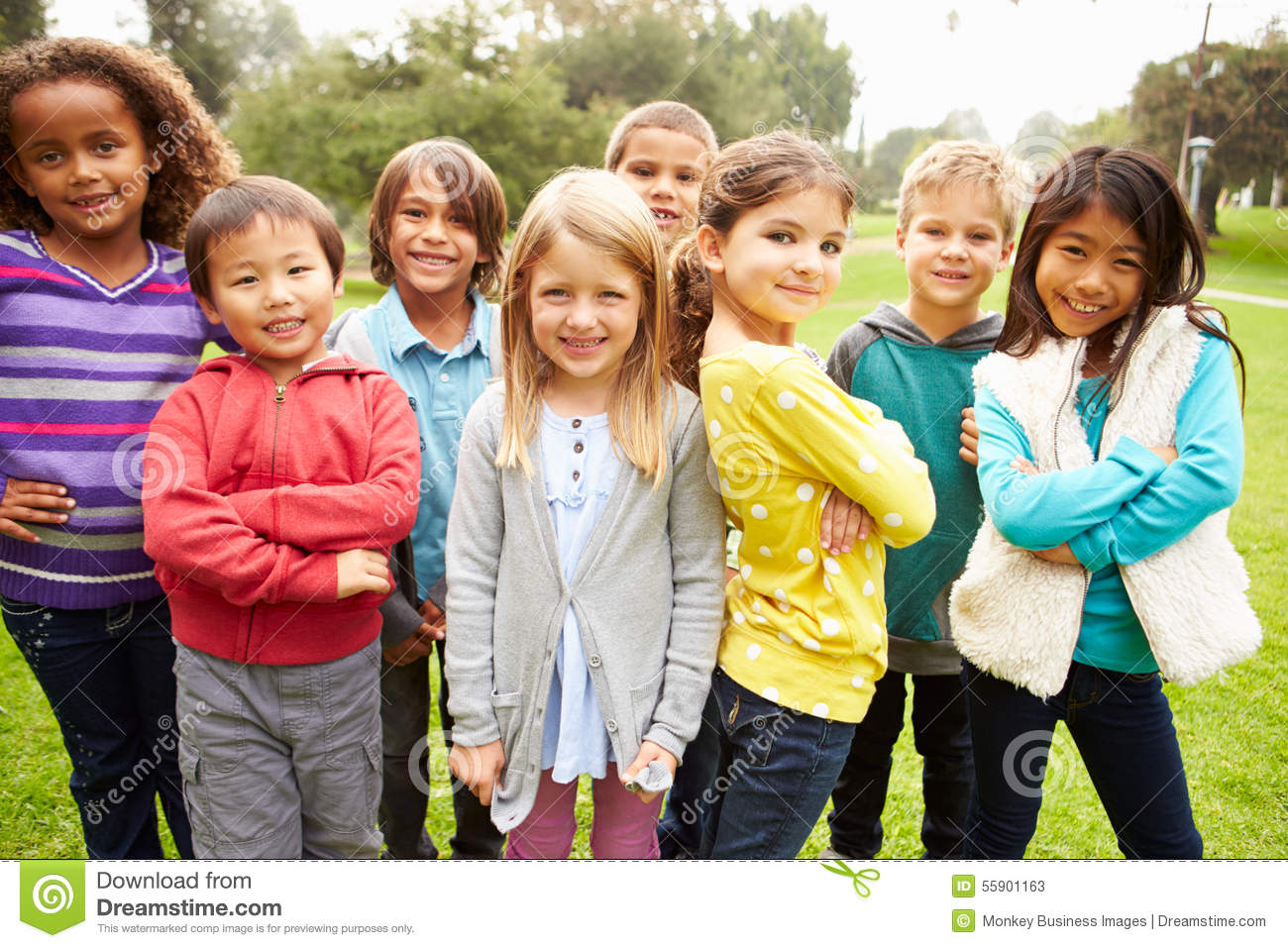 Group of young children hanging out in park stock photo for Hanging groups of pictures