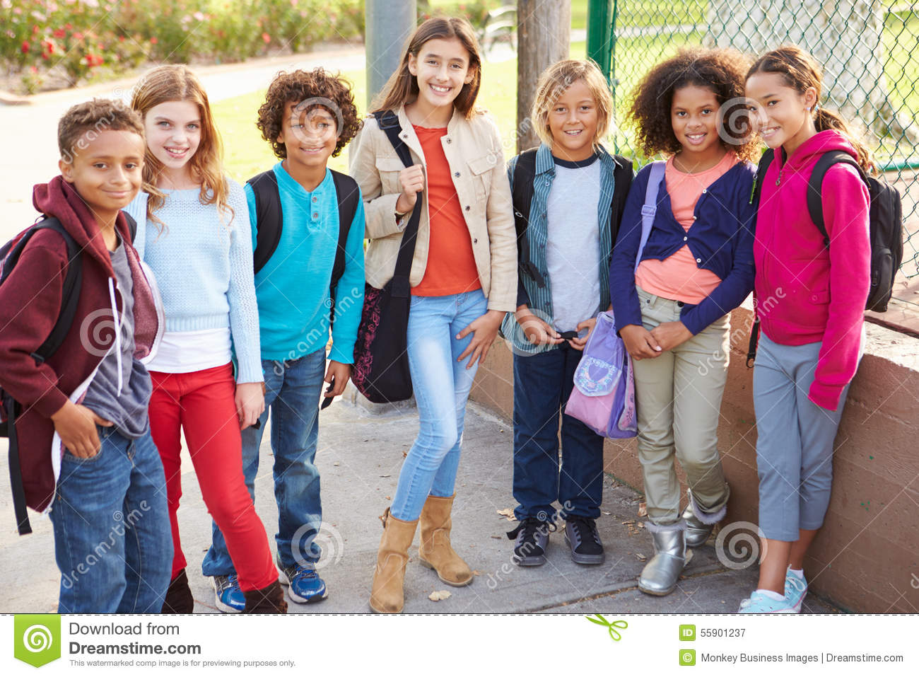 Group of young children hanging out in playground stock for Hanging groups of pictures