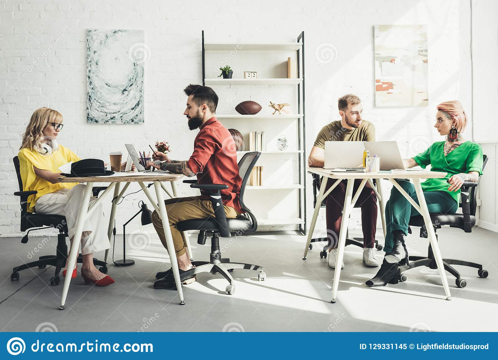 Group of young creative workers working on project in office royalty free stock photo