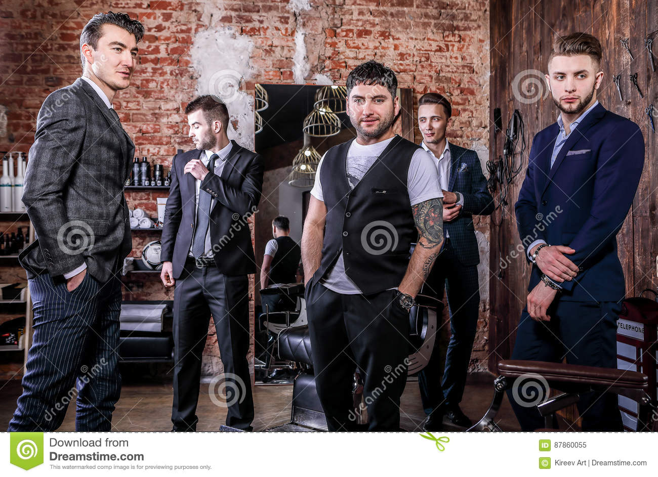 Group of young elegant positive mens pose in interior of barbershop.