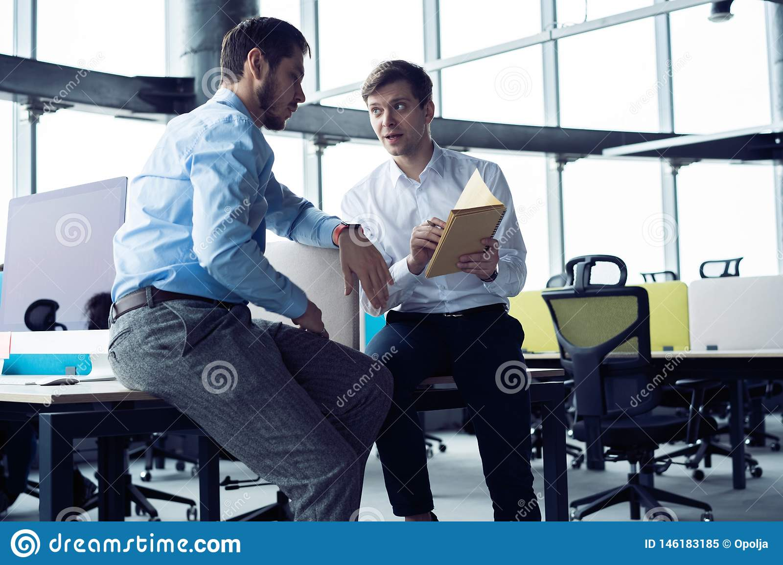 Group of young entrepreneurs are looking for a business solution during work process at office.Business people meeting