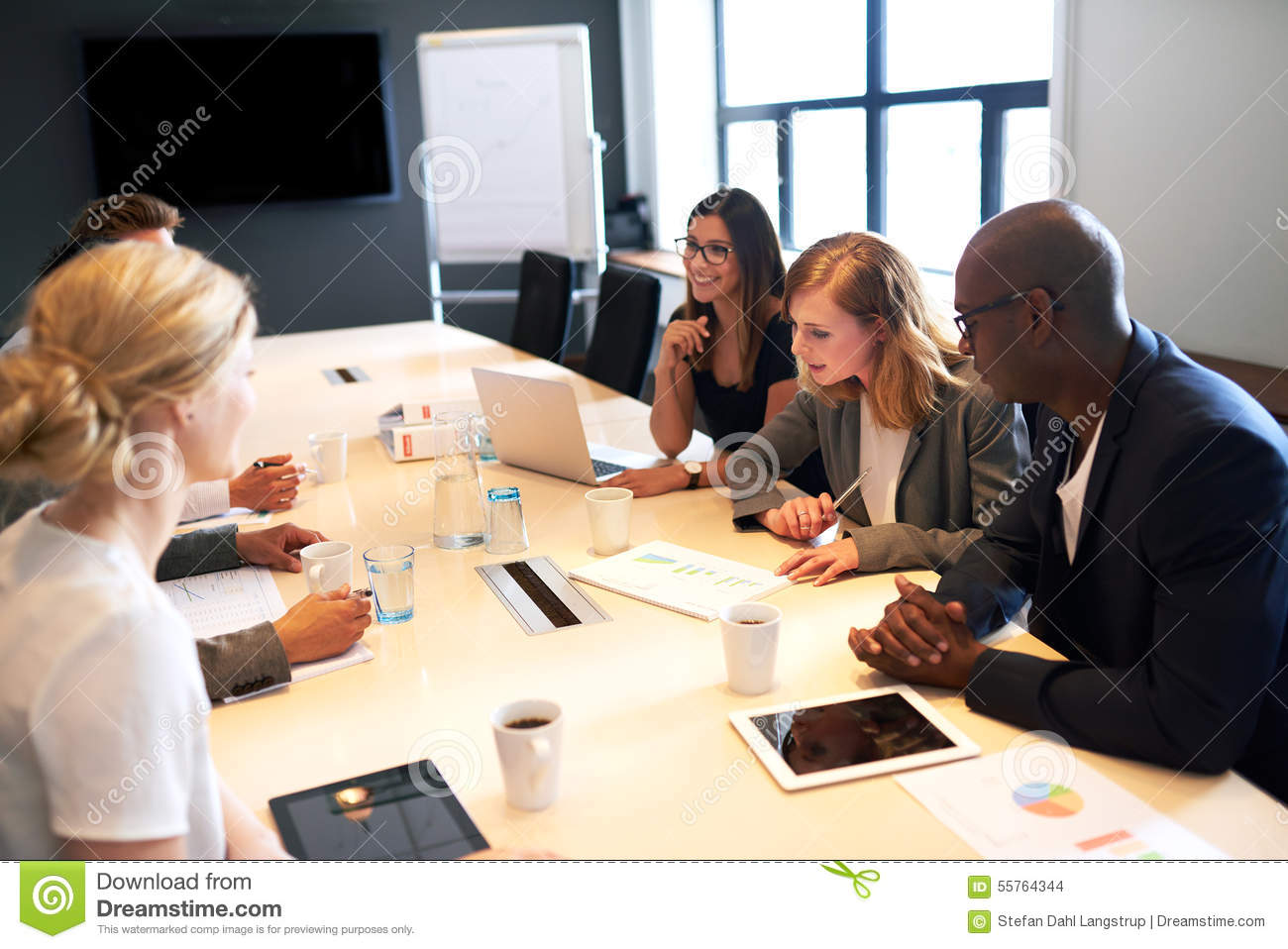 Group Of Young Executives Having A Work Meeting Stock