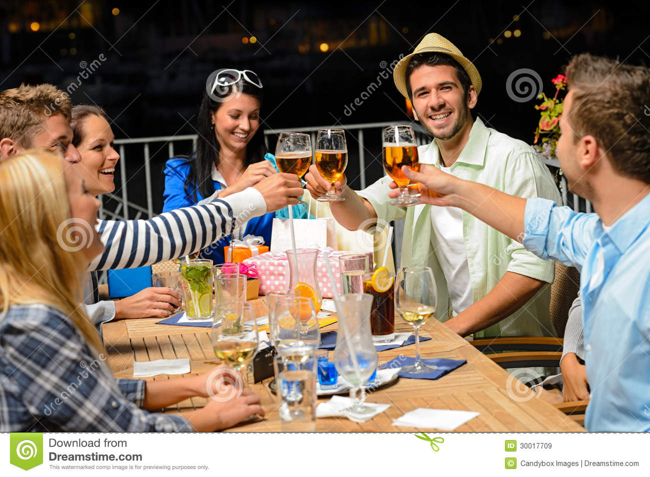 Group of young friends drinking beer outdoors stock image for The terrace group