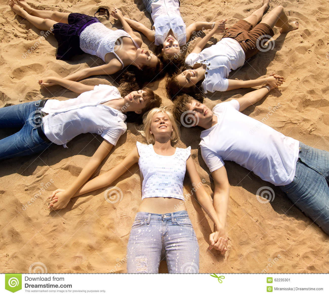 Couple Enjoying Their Summer Holidays Stock Photo: Group Young Friends Enjoying A Beach Party On Vacation