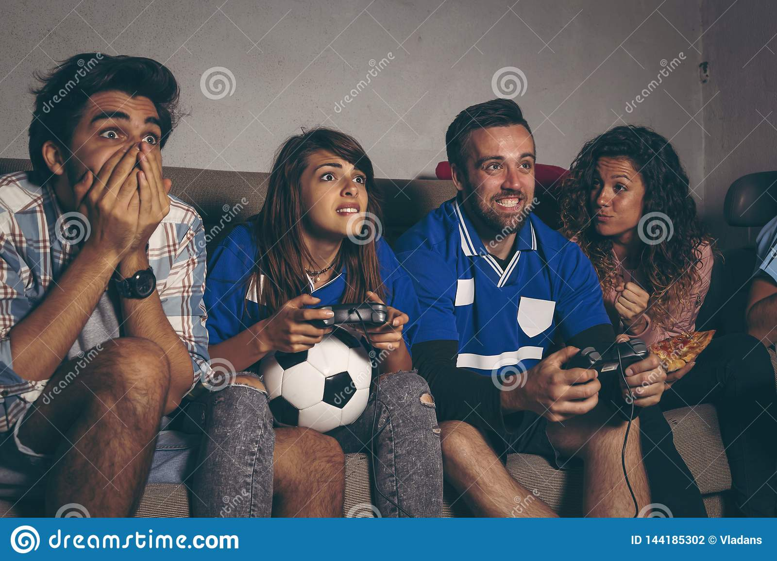 Football fans playing a football video game