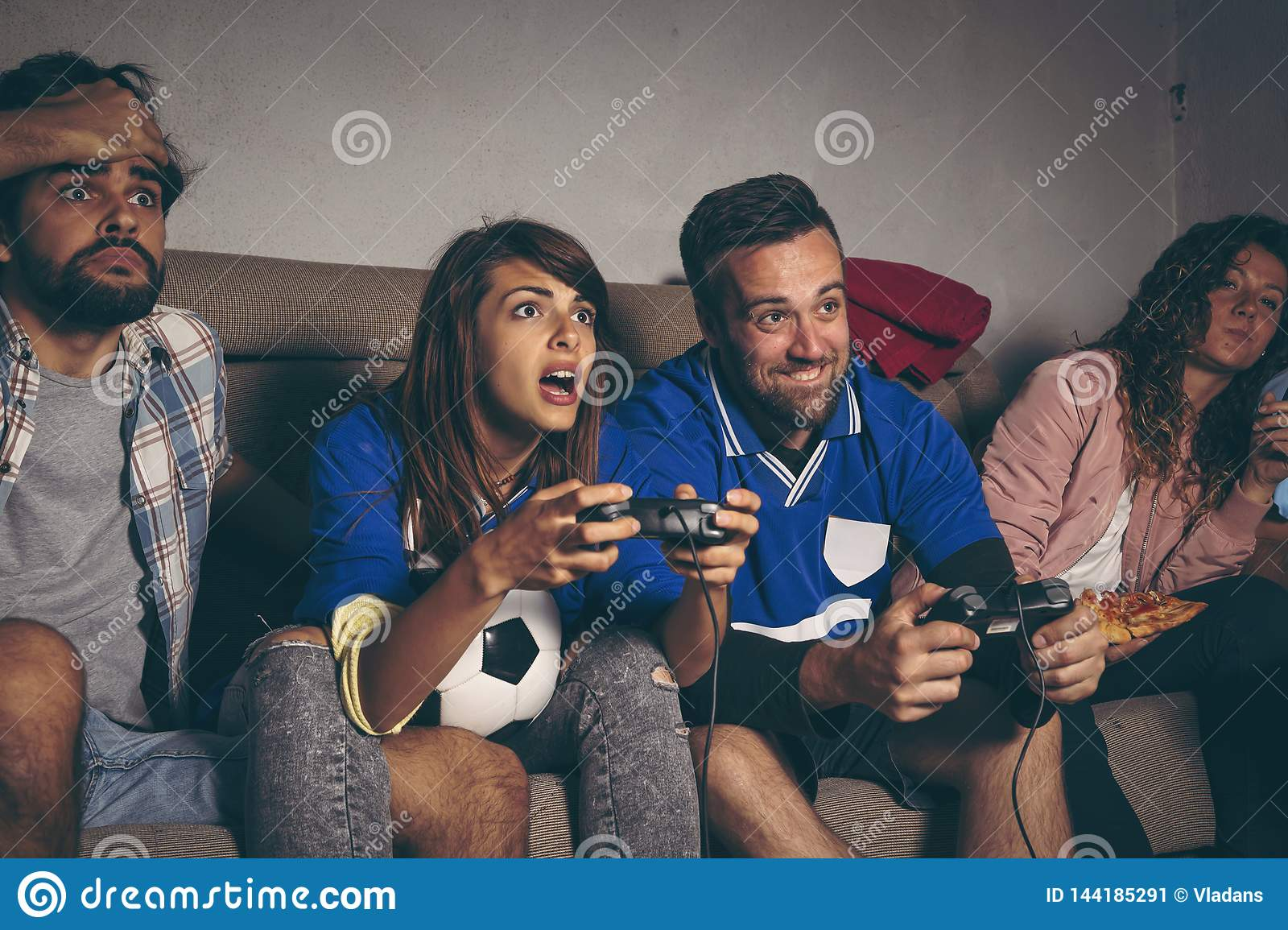 Friends playing a football video game