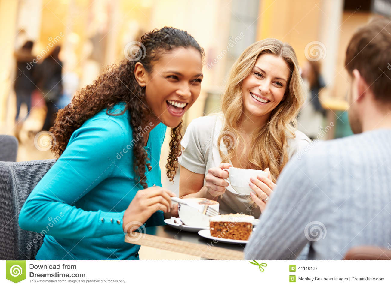 Group Of Young Friends Meeting In Cafe