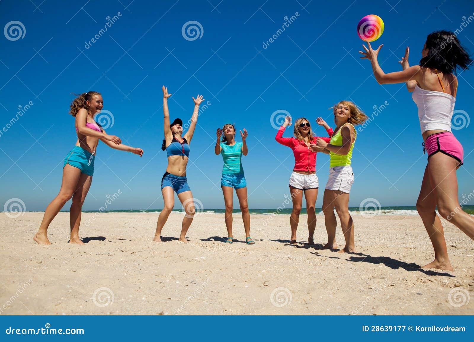 Group Young Joyful Girls Playing Volleyball On Beach Stock