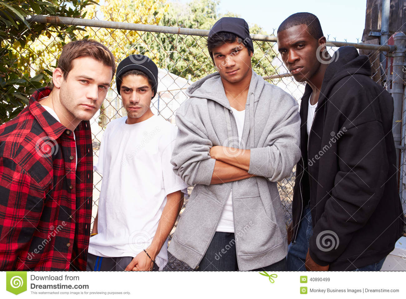 Group Of Young Men In Urban Setting Standing By Fe