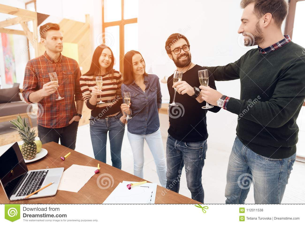 A group of young office workers celebrating.