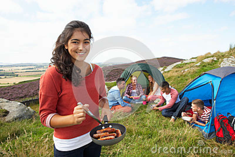Group Of Young People On Camping Trip In Countryside ...