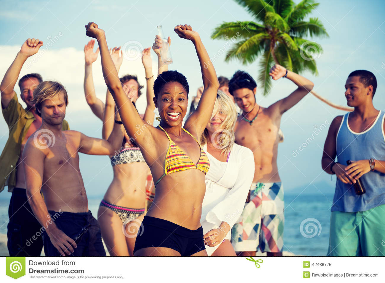 Group Of Young People Celebrating By The Beach