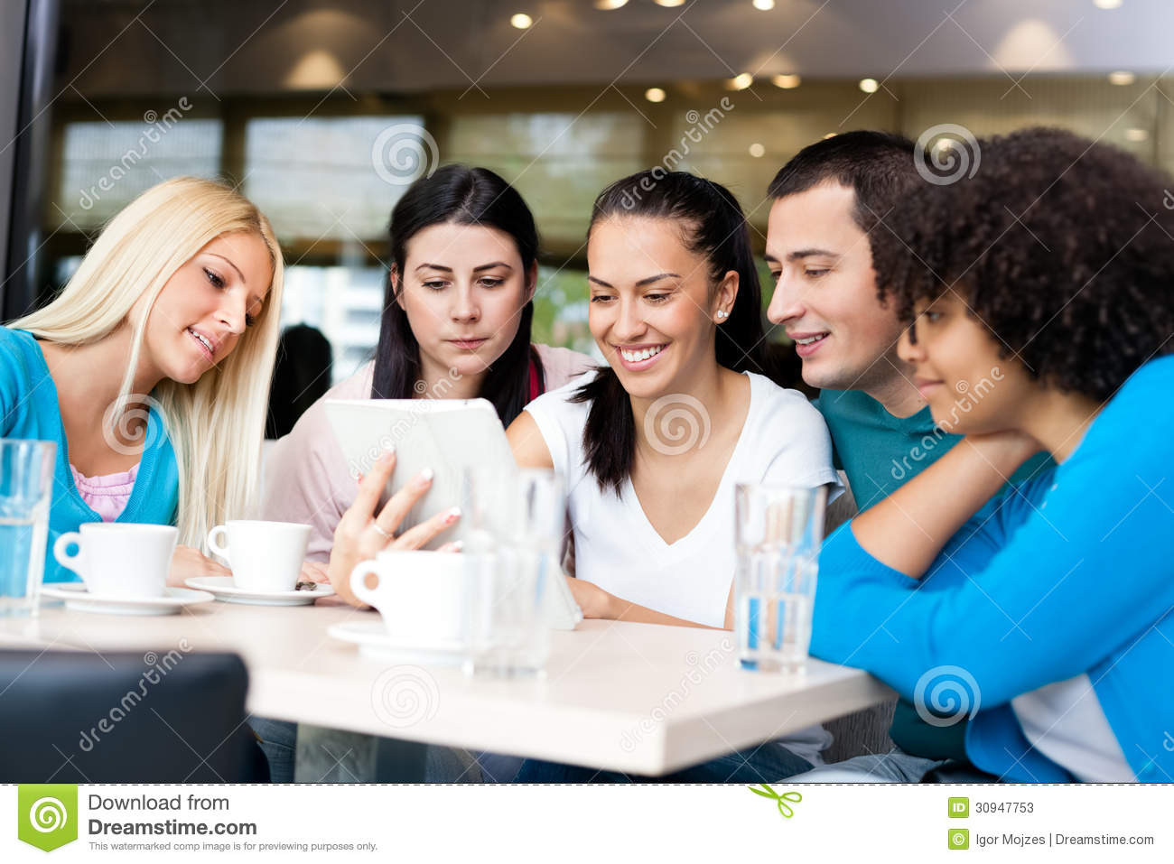 Group Of Young People In Modern Cafe Stock Photos Image