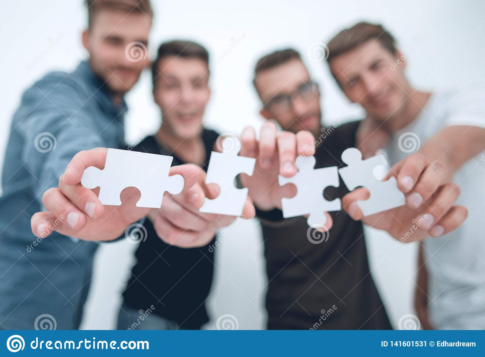 Group of young people with puzzle pieces