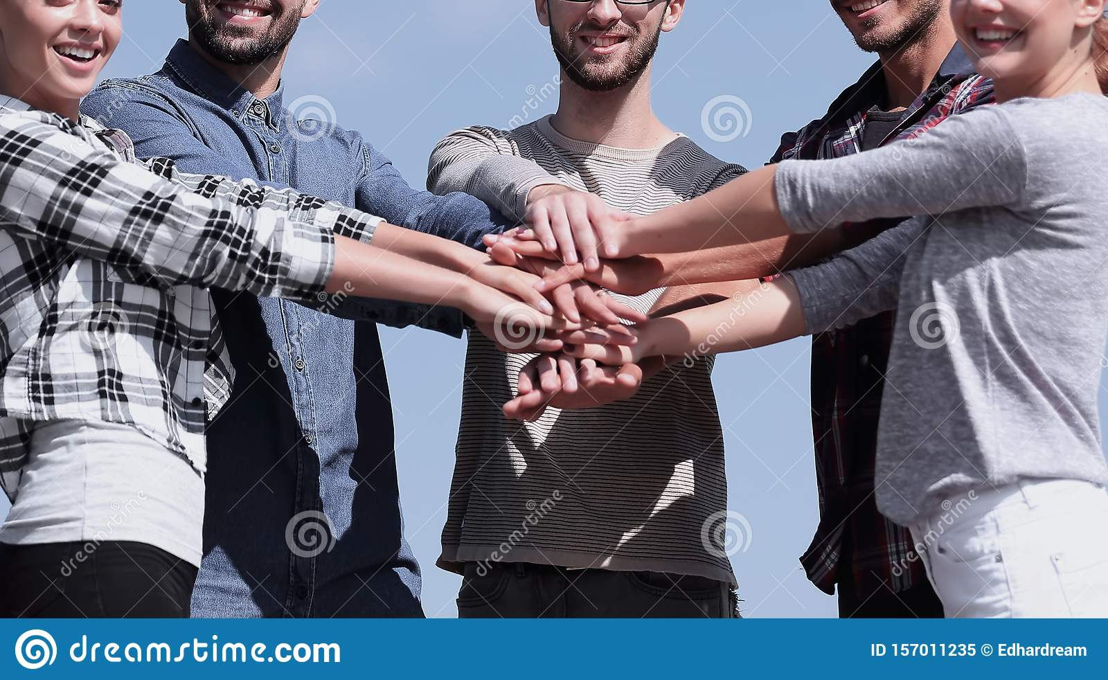 Group of young people shows their unity.