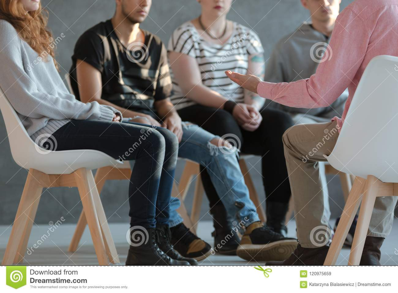 Group of young people sitting in a circle and talking to a psych