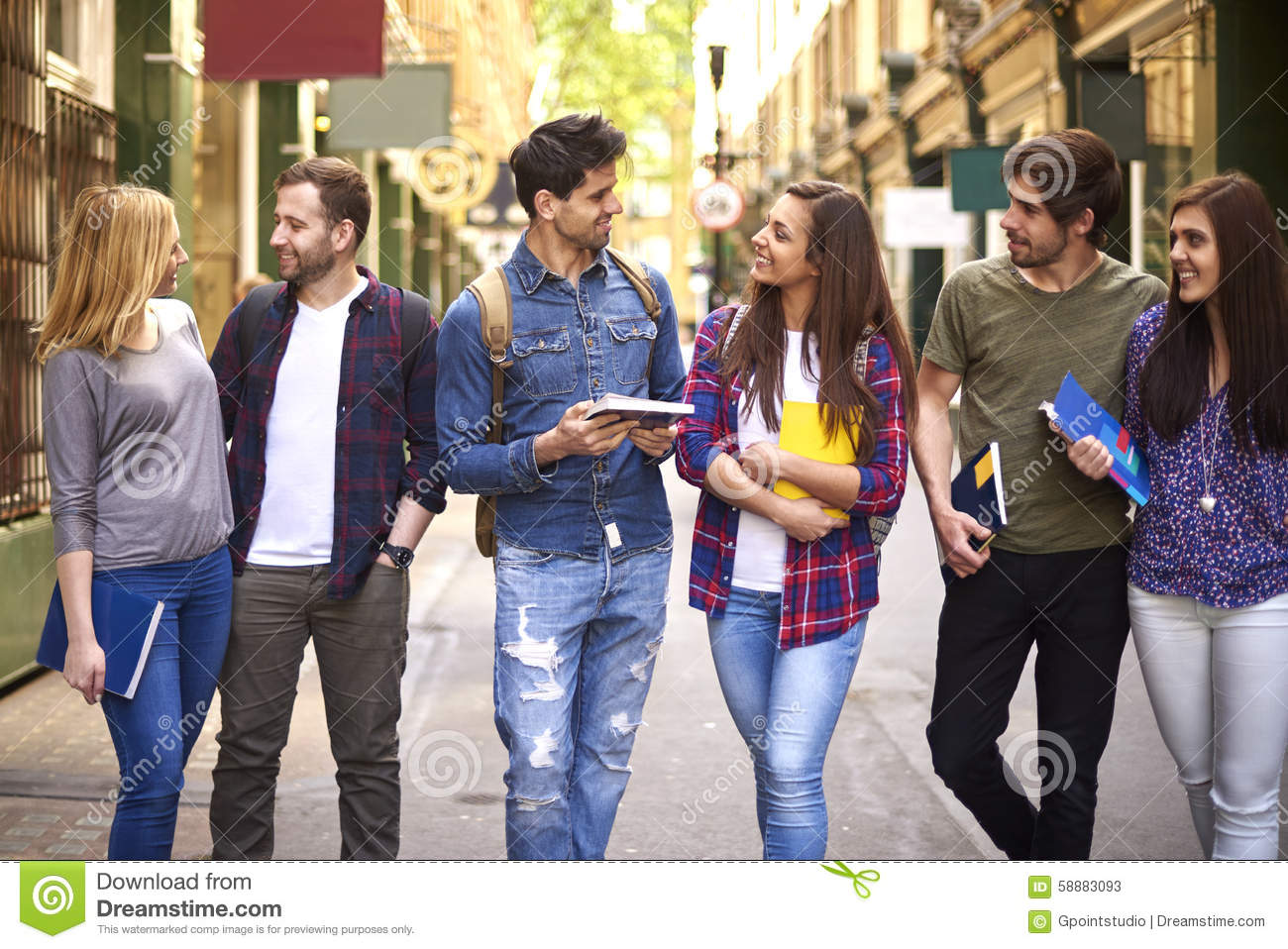 Group Of Young People Walking Through The City Stock Photo ...