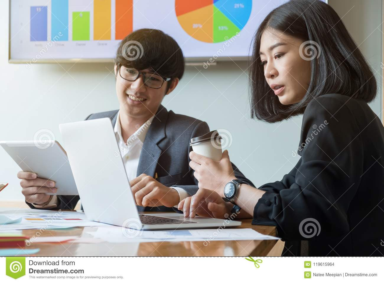 Group of young successful businessmen. Discussion of the important contract of the company with modern laptop computer and