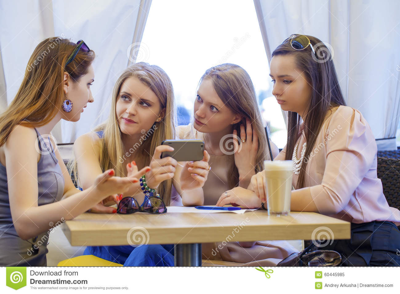 Group of young women sitting around table eating dessert for Eating table