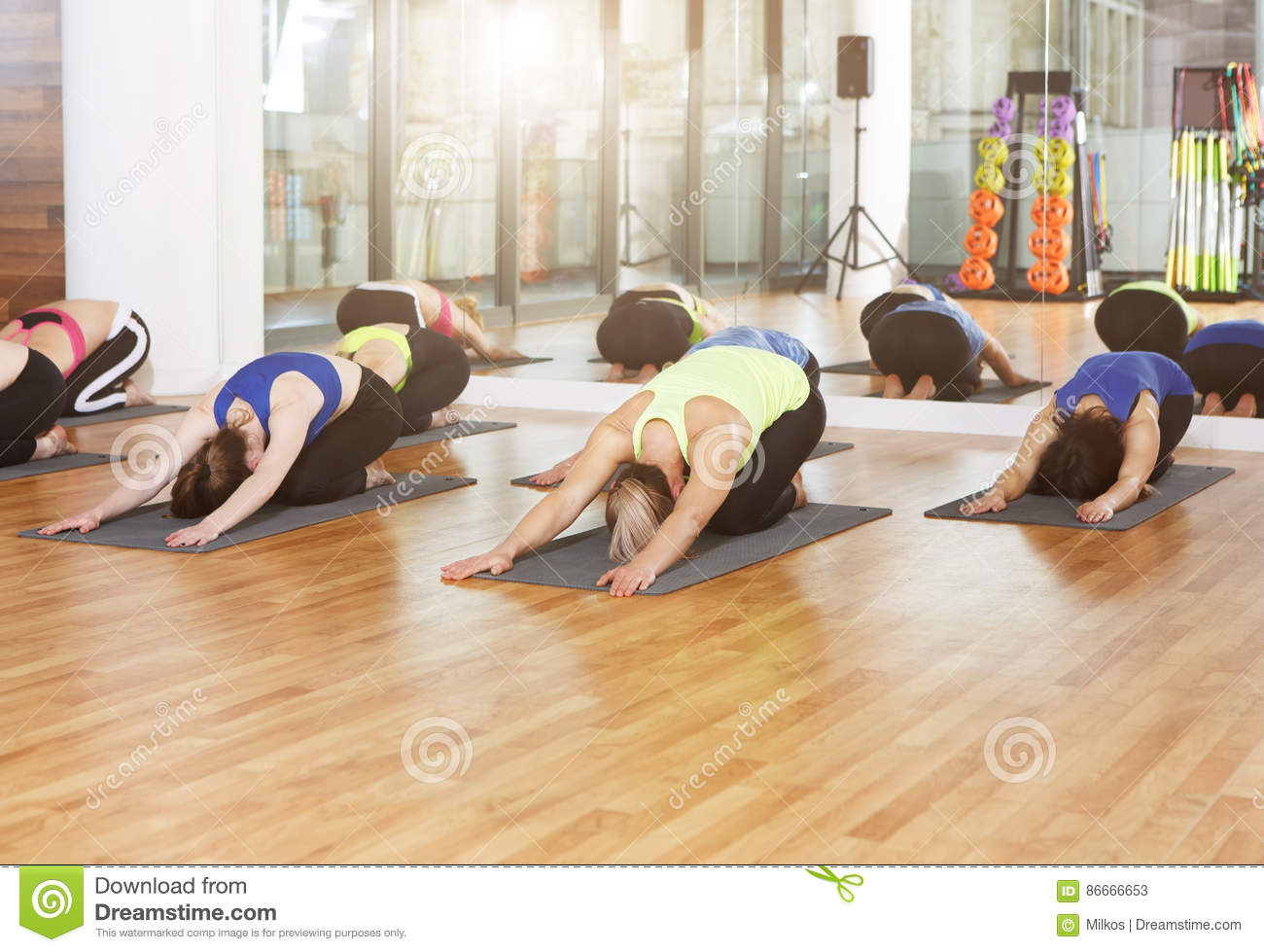 Group of young women in yoga class