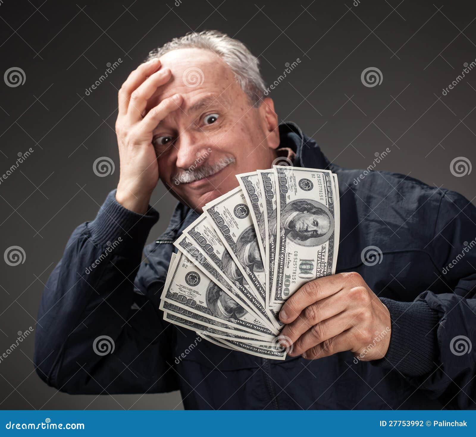 Groupe de fixation de vieil homme de billets d un dollar