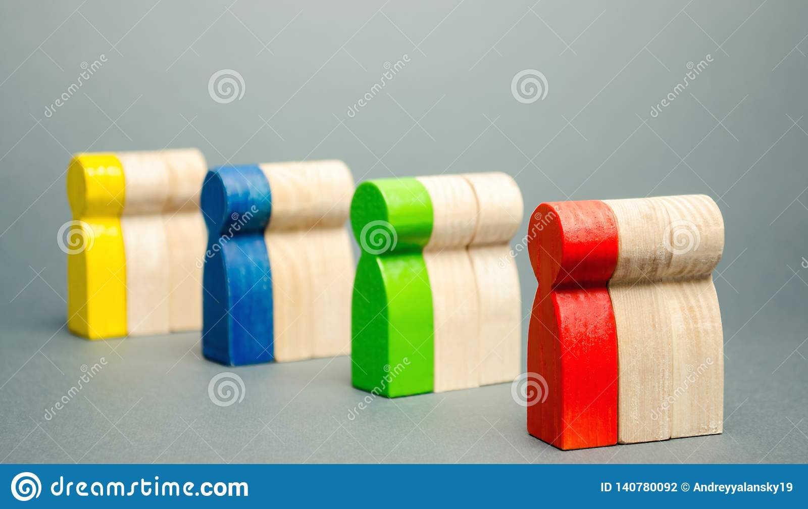 Groups of multicolored wooden people. The concept of market segmentation. Target audience, customer care. Market group of buyers.