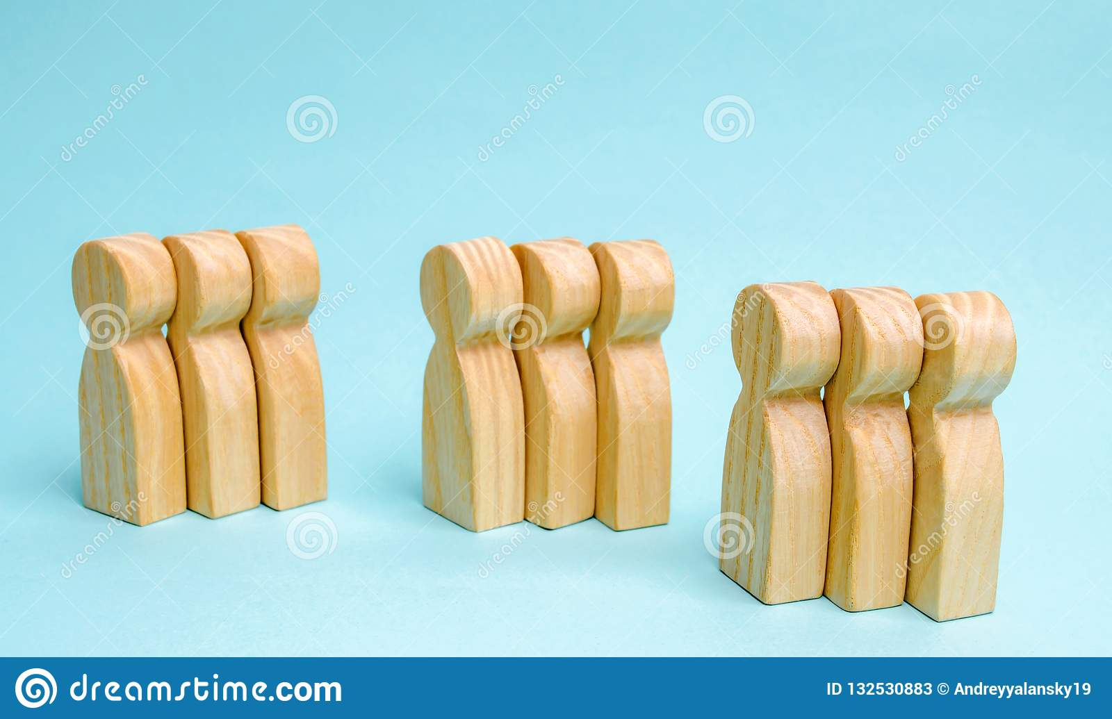 Groups of wooden people. The concept of market segmentation. Mar